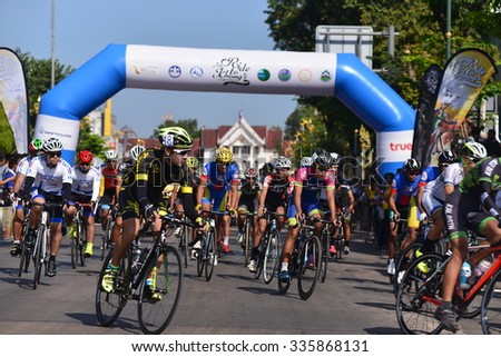 "Nong KHAI THAILAND October 30,2015:People ride bicycles in ""Ride to Khong's Legendary"", the road bicycle race through four provinces along the Mekong River, from Oct 29 to Nov 1 in Nong Khai,Thailand  - stock photo"