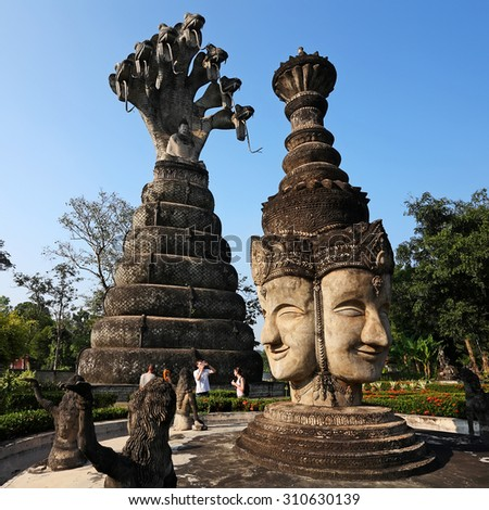 NONGKHAI, THAILAND- NOV 2 : Unidentified foreign tourists walk around the old Buddha statues park at Sala Kaeo Ku on November 2, 2010 in Nongkhai. It is a Buddha idol and shrines all 208 elements - stock photo