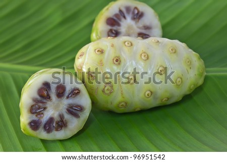Noni fruit on banana leaf