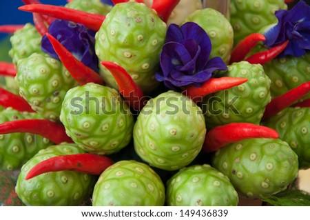 Noni fruits - stock photo