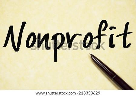 nonprofit word write on paper  - stock photo