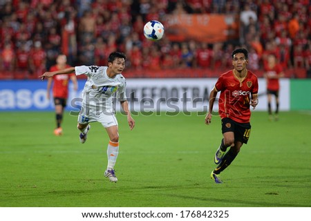NONTHABURI-FEB 8,Nguyen Hong Tien(W)of Hanoi T&T Jump tackles football during AFC Champions League 2014 between SCG Muangthong utd and Hanoi T&T at SCG Stadium on February8,2014 in Thailand