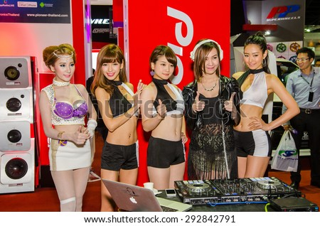 NONTHABURI - JUNE 24 : Unidentified model of japan with Disk Jockey on display at Bangkok International Auto Salon 2015 is Exciting Modified Car Show on June 24, 2015 in Nonthaburi, Thailand. - stock photo