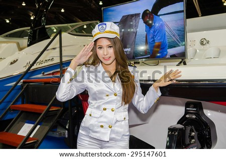 NONTHABURI - JUNE 24 : Unidentified model with boat on display at Bangkok International Auto Salon 2015 is Asean's biggest and most Exciting Modified Car Show on June 24, 2015 in Nonthaburi, Thailand. - stock photo