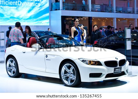 NONTHABURI - MARCH 26:An unidentified modelling post over BMW Z4 sDrive2.0i Highline showed in 34th Bangkok International Motor Show on March 26, 2013 in Nonthaburi, Thailand. - stock photo