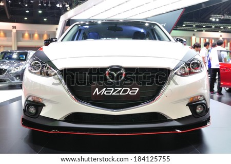 NONTHABURI - MARCH 25: New Mazda 3 on display at The 35th Bangkok International Motor show on MARCH 25, 2014 in Nonthaburi, Thailand. - stock photo