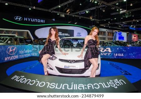 NONTHABURI - NOVEMBER 28:  Hyundai Elantra with Unidentified model on display at Thailand International Motor Expo 2014 on November 28, 2014 in Nonthaburi, Thailand. - stock photo