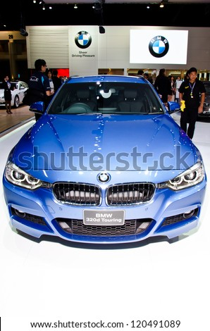 NONTHABURI - NOVEMBER 28: The BMW 320d Touring car on display at The 29th Thailand International Motor Expo on November 28, 2012 in Nonthaburi, Thailand. - stock photo