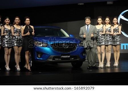 NONTHABURI - NOVEMBER 28: Unidentified modellings posted over Mazda CX-5 display on stage at The 30th Thailand International Motor Expo on November 28, 2013 in Nonthaburi, Thailand.