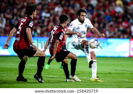 NONTHABURI THAI-FEB 21:Diogo Luis Santo(W) of Buriram Utd.hit the ball during the Thai Premier League 2015 between SCG Muangthong UTD. and Buriram UTD.at SCG Stadium on February 21,2015 in,Thailand - stock photo