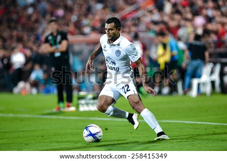 NONTHABURI THAI-FEB 21:Gilberto Macena of Buriram Utd.in action during the Thai Premier League 2015 between SCG Muangthong UTD. and Buriram UTD.at SCG Stadium on February 21,2015 in,Thailand - stock photo