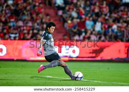 NONTHABURI THAI-FEB 21:Goalkeeper Kawin Thamsatchanan of Muangthong Utd.hit the ball during Thai Premier League between SCG Muangthong UTD.and Buriram UTD.at SCG Stadium on February 21,2015in,Thailand - stock photo