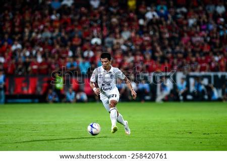 NONTHABURI THAI-FEB 21:Prakit Deeprom of Buriram Utd.kicks the ball during the Thai Premier League 2015 between SCG Muangthong UTD. and Buriram UTD.at SCG Stadium on February 21,2015 in,Thailand - stock photo