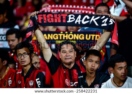 NONTHABURI THAI-FEB 21:SCG Muangthong United fans cheer  during the Thai Premier League 2015 between SCG Muangthong UTD. and Buriram UTD.at SCG Stadium on February 21,2015 in,Thailand - stock photo