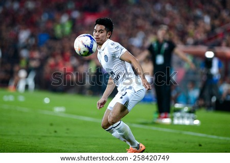 NONTHABURI THAI-FEB 21:Theerathon Bunmathan of Buriram Utd.in action during Thai Premier League 2015 between SCG Muangthong UTD. and Buriram UTD.at SCG Stadium on February 21,2015 in,Thailand - stock photo