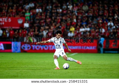 NONTHABURI THAI-FEB 21:Theerathon Bunmathan of Buriram Utd.kicks the ball during Thai Premier League 2015 between SCG Muangthong UTD. and Buriram UTD.at SCG Stadium on February 21,2015 in,Thailand - stock photo