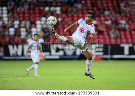 NONTHABURI THAI-JUN14:Wanmai Sethtanan of M-150 Saraburi contols the ball during Thai Premier League between SCG Muangthong Utd and Osotspa M-150 Saraburi F.C. at SCG Stadium on June 14,2014,Thailand - stock photo