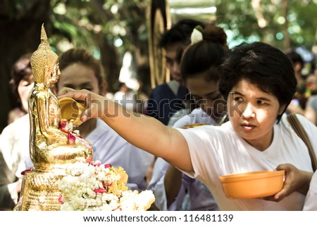 NONTHABURI THAILAND-APRIL 13: people  showering buddha statue in Songkran festival in templed on April 13, 2012 in Nonthaburi,Thailand. - stock photo
