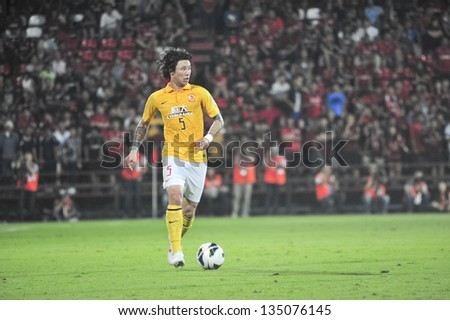 NONTHABURI, THAILAND- APRIL 9 : Zhang Linpeng in action during AFC Champions  League 2013  Between Muangthong Utd (R) VS Guangzhou Evergrande (Y) on April 9, 2013 at SCG Stadium, Bangkok, Thailand - stock photo