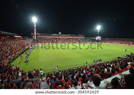 NONTHABURI THAILAND- AUG 9: Cheering fans in action during the Thai Premiel League 2015 beween MTUTD and BGFC at SCG Stadium on August 9, 2015 in Thailand. - stock photo