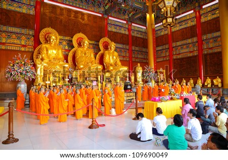 NONTHABURI, THAILAND - AUGUST 5 : Chinese monks and Chinese peoples show great faith by worship and pray to the Buddha in the morning at Leng Noei Yi 2 temple on August 5,2012 in Nonthaburi, Thailand