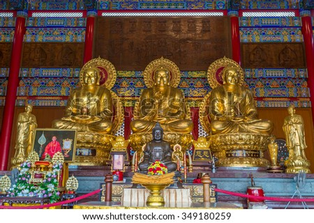 Nonthaburi, Thailand - Dec 7, 2015 Three Gold Buddha at Wat Leng Nei Yee 2 or Wat Borom Racha Khanchanapisek Memorial. The atmosphere which is recited in ancient Chinese temple.