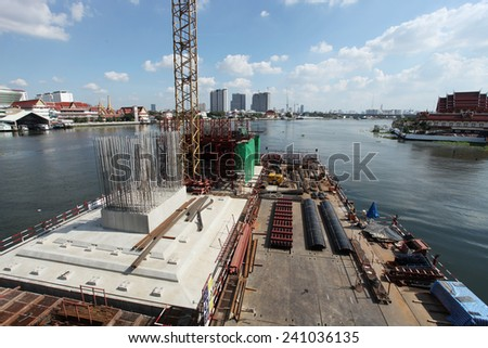 NONTHABURI -THAILAND - DECEMBER 7 : Concrete bridge across Chaophraya river under-construction of its foundation and column on Dec 7, 2014 in Nonthaburi, Thailand