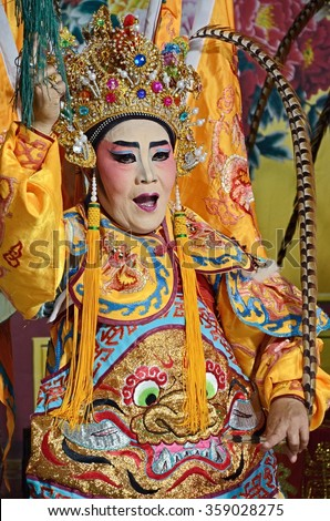 Nonthaburi, THAILAND - Feb 24, 2015: Actors (Unidentified) appear in a free admission public showing of Chinese opera on a street in Pak Kret District .