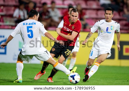 NONTHABURI-THAILAND FEB 8:	Mario Gjurovski (red) of Muangthong utd. in action  during the AFC Champions League2014 Muangthong utd. and Hanoi T&T at SCG Stadium on February 8,2014 in Thailand.
