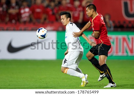 NONTHABURI-THAILAND FEB 8: Nguyen Van Quyet #10 (white)of Hanoi T&T in action during the AFC Champions League 2014 between Muangthong utd and Hanoi T&T at SCG Stadium on February 8, 2014 in Thailand.