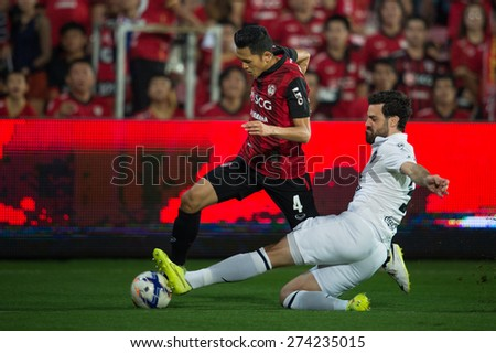 NONTHABURI THAILAND-FEBRUARY 21:	Andres Tunez(white) of  Buriram United in action during Thai Premier League between Muangthong Utd.and Buriram United at SCG Stadium on Feb 21, 2015,Thailand - stock photo