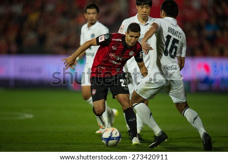 NONTHABURI THAILAND-FEBRUARY 21:	Cleiton Silva  (red)of Muangthong utd. in action during Thai Premier League between Muangthong Utd.and Buriram United at SCG Stadium on Feb 21, 2015,Thailand - stock photo