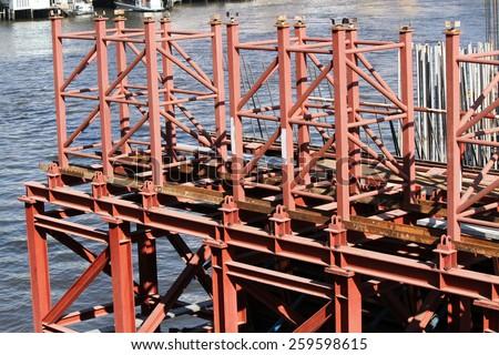 NONTHABURI -THAILAND - FEBRUARY 22 : Concrete bridge across Chaophraya river under-construction of its abutment of speed way on Feb 22, 2015 in Nonthaburi, Thailand - stock photo
