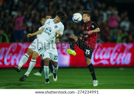NONTHABURI THAILAND-FEBRUARY 21:	Go Seul-ki (white) of  Buriram United. in action during Thai Premier League between Muangthong Utd.and Buriram United at SCG Stadium on Feb 21, 2015,Thailand - stock photo