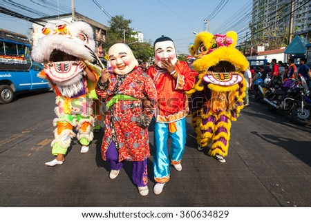 NONTHABURI, THAILAND - February 27 2015: Lions dance parade on street through large crowds during Chinese new year celebrations on February 27, 2015 Nonthaburi, Thailand.