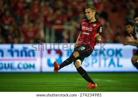 NONTHABURI THAILAND-FEBRUARY 21:	Mario Gjurovski (RED) of  Muangthong Utd. in action during Thai Premier League between Muangthong Utd.and Buriram United at SCG Stadium on Feb 21, 2015,Thailand - stock photo