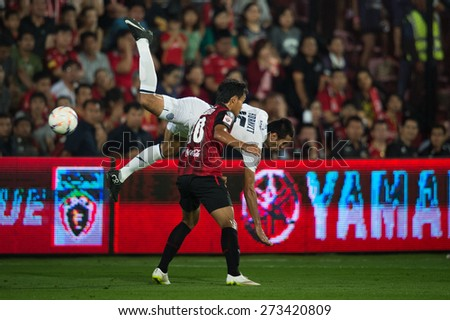 NONTHABURI THAILAND-FEBRUARY 21:Teerasil Dangda no.10 (red) of Muangthong utd. in action during Thai Premier League between Muangthong Utd.and Buriram United at SCG Stadium on Feb 21, 2015,Thailand - stock photo