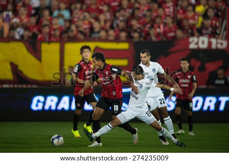 NONTHABURI THAILAND-FEBRUARY 21:	Teerasil Dangda no.10(RED) of  Muangthong Utd. in action during Thai Premier League between Muangthong Utd.and Buriram United at SCG Stadium on Feb 21, 2015,Thailand - stock photo