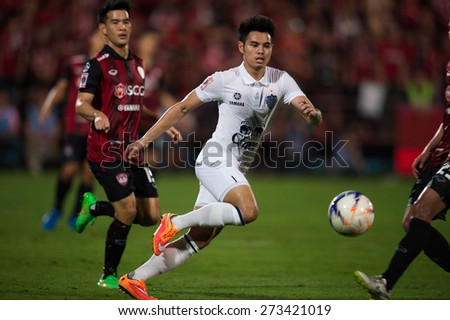 NONTHABURI THAILAND-FEBRUARY 21:	Theerathon Bunmathan. (white) of Buriram United in action during Thai Premier League between Muangthong Utd.and Buriram United at SCG Stadium on Feb 21, 2015,Thailand - stock photo