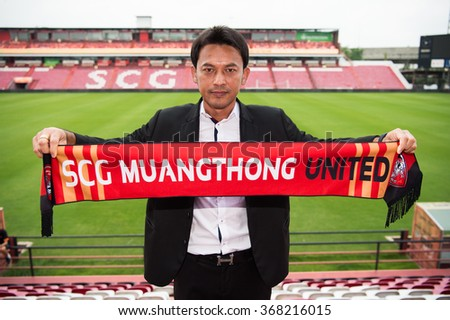 NONTHABURI THAILAND-Jan 21:New head coach Totchtawan Sripan pose with scarf his press conference as a new player for SCG Muangthong United at SCG Stadium on Jan 21,2016 in Nonthaburi,Thailand - stock photo