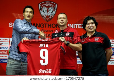 NONTHABURI-THAILAND JANUARY 8:Jay Bothroyd (L) poses with Manager	Scott Cooper during press conference as a new player for SCG Muangthong United at SCG Stadium on January 8,2014 in Nonthaburi,Thailand - stock photo