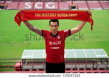NONTHABURI-THAILAND JANUARY 8: Jay Bothroyd pose with scarf  his press conference as a new player for SCG Muangthong United at SCG Stadium on January 8, 2014 in Nonthaburi,Thailand - stock photo