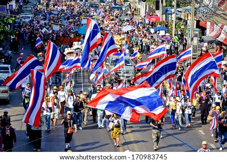 """NONTHABURI,THAILAND- JANUARY 13 : Unidentified protesters protest against Thai government corruption walking to join """"Shut down Bangkok"""" campaign. on January 13,2014 in Bangkok,Thailand. - stock photo"""