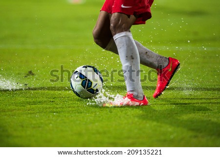 NONTHABURI THAILAND-Jul30:Soccer shoes Football being kicked on lawn during the LFP World Challenge 2014 between SCG Muangthong UTD. and Almeria at SCG Stadium on July30,2014,Thailand - stock photo