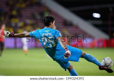 NONTHABURI THAILAND-JUN14:Goalkeeper of M-150 Saraburi F.C.hit the ball during a Thai Premier League between SCG Muangthong Utd and Osotspa M-150 Saraburi F.C. at SCG Stadium on June 14,2014,Thailand - stock photo