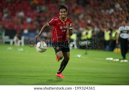 NONTHABURI THAILAND-JUN14:Teerasil Dangda of SCG MUTU.runs for the ball during Thai Premier League between SCG Muangthong Utd and Osotspa M-150 Saraburi F.C. at SCG Stadium on June 14,2014,Thailand - stock photo