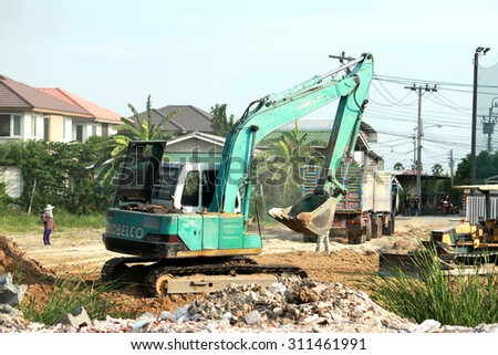 NONTHABURI-THAILAND-JUNE 6 : A loader & truck working in workside on June 6, 2015 at Nonthaburi Province, Thailand. - stock photo