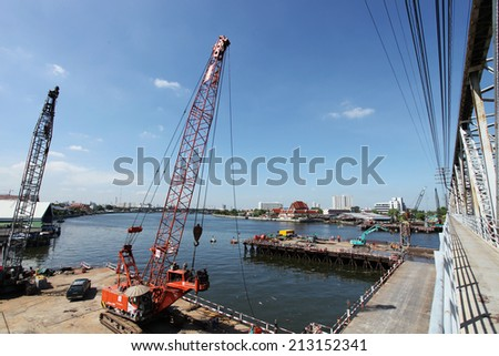 NONTHABURI -THAILAND - JUNE 21 : Concrete bridge across Chaophraya river under-construction of its deep long pile foundation on June 21, 2014 in Nonthaburi, Thailand