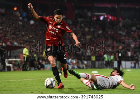 NONTHABURI-THAILAND MAR16:Thitipan Puangchan of Muangthong Utd in action during Thai Premier League2016 between Muangthong Utd and BEC-TeroSasana at SCG Stadium on March 16,2016 in Nonthaburi,Thailand - stock photo