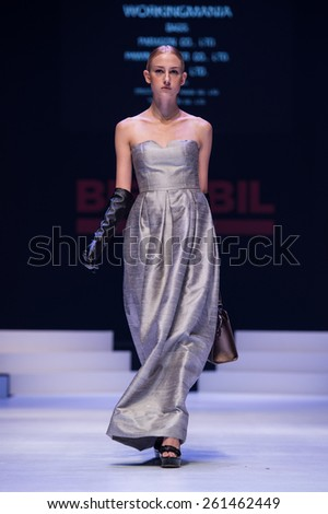 NONTHABURI THAILAND- MARCH 12:A model walks the runway the Workingmania show during The BIFF&BIL Bangkok international Fashion Fair 2015 at IMPACT Challenger Hall on March 12,2015 in,Thailand